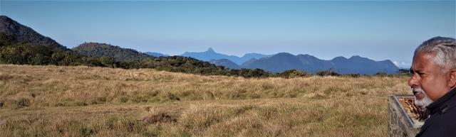 Upali pointing out Adam's Peak and other peaks on the horizon at Horton Plains  (photo copyright Mike Jarvis)