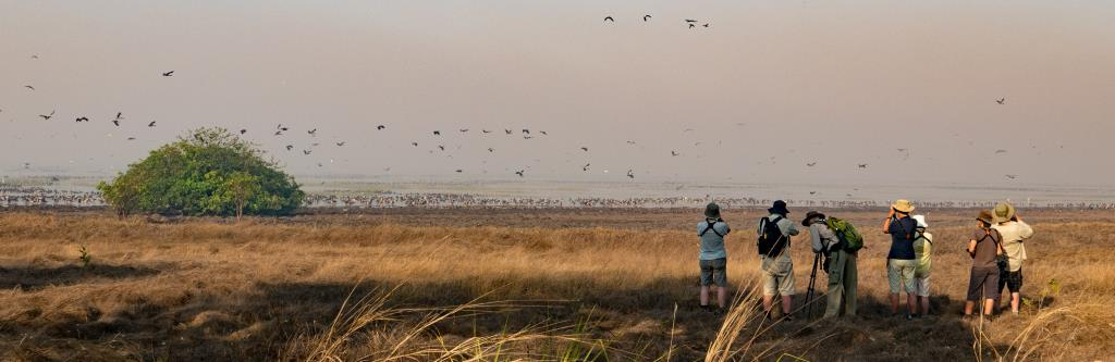 Group at Mumukala wetland, early morning mist and smoke and thousands of waterbirds  (photo copyright Marg Lacey)